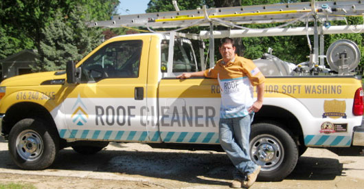 Roof Cleaner owner, Dan Dykstra with pressure washing truck