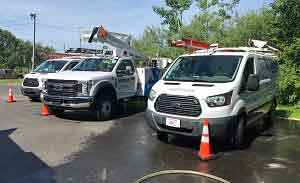Washing a fleet of trucks with Roof Cleaner's mobile truck washing service near grand rapids, mi