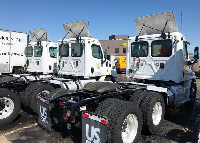 Roof Cleaner washed these semi truck cabs with their touchless truck washing system in west michigan